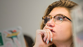 a student listens to a course lecture
